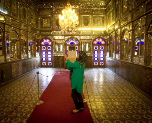 A tourist takes photos while visiting Golestan Palace in Tehran