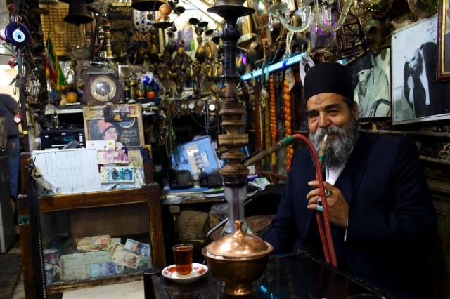 Esfahan, Iran - An old man smoking Narguile in the bazaar of Isfahan, Iran, Middle East