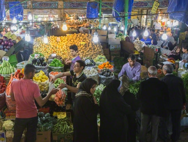 Tehran, Iran --- Iranians shop at a bazaar in Tehran,