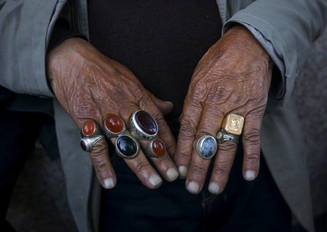 Iran, Shemiranat County, Tehran, man selling rings in tajrish bazaar