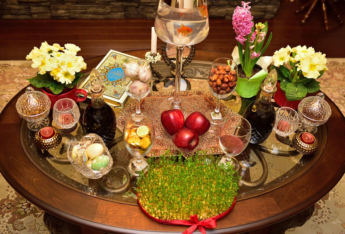 The traditional New Year's spread (sofre-ye haft sin) features seven items that begin with the letter S sabzeh (sprouts), samanu (pudding), sib (apple), serkeh (vinegar), sir (garlic), senjed (dried oleaster), and somaq (a fruity spice). The spread also typically includes other items such as a copy of the Qur'an, a mirror, and live goldfish. The Iranian New Year, Noruz, is the most important festival of the year and is celebrated by peoples from the Balkans to Central Asia and India.