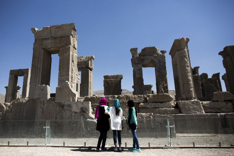 Tourists Admire The Palace Of King Darius Of Achaemenid In Persepolis, Iran.