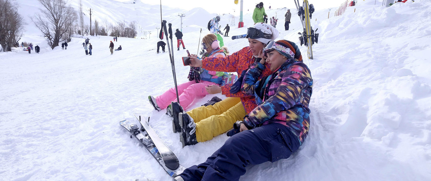 Young people skiing at the Dizin ski resort