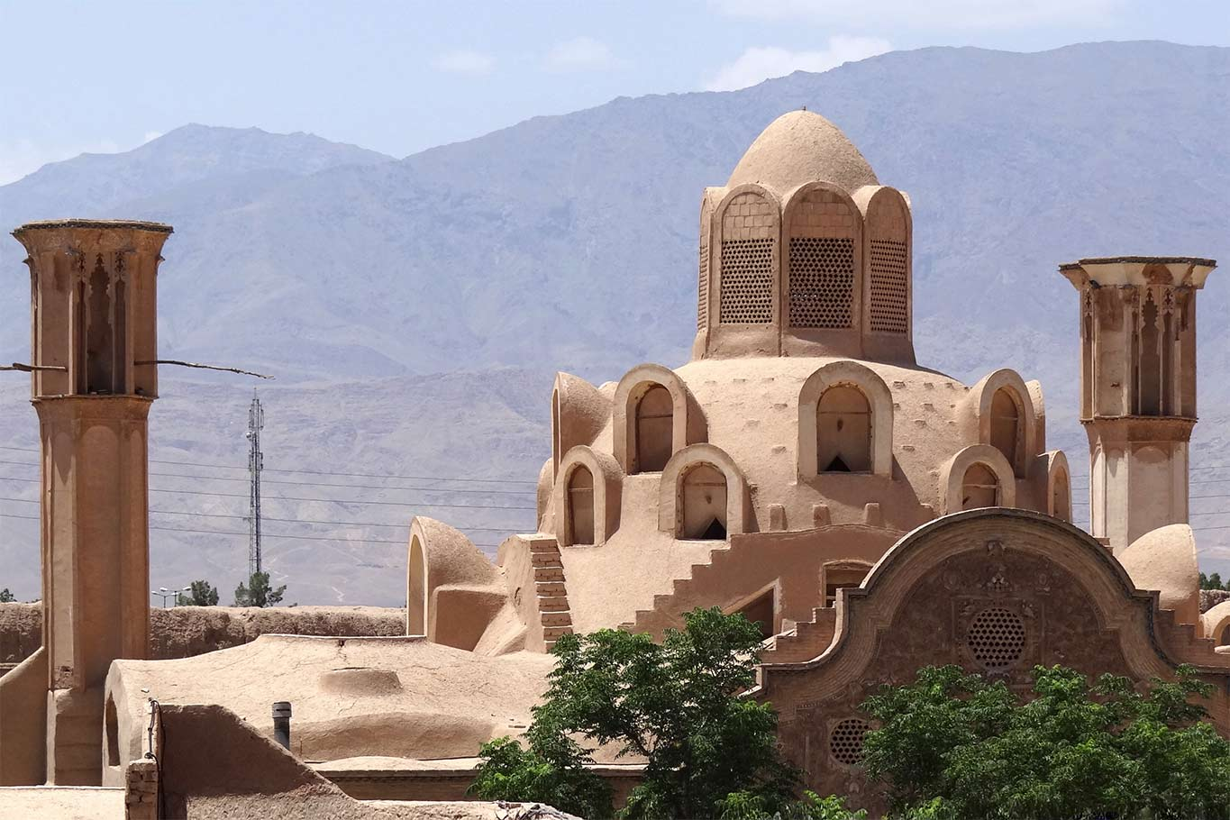 Borujerdi House, in Kashan, central Iran. Built in 1857, it is an excellent example of ancient Persian desert architecture. The two tall windcatchers cool the andaruni (courtyard) of the house.
